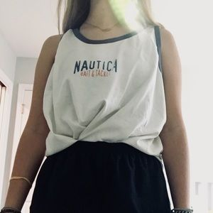 white nautica tank top with blue and pink writing